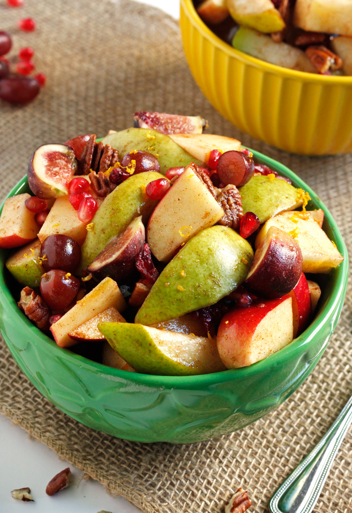 A fall fruit salad recipe bursting with the season's best-- pomegranates, figs, pears, grapes, apples, pecans, and craisins. All coated in the most delicious, cozy maple cinnamon dressing. Perfect for Thanksgiving! ♡ passthechallah.com
