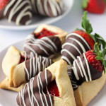 Chocolate Covered Strawberry Hamantaschen- Chocolate covered strawberry hamantaschen are sure to impress! A great way to jazz up your favorite hamantaschen recipe while also hiding the imperfections. passthechallah.com