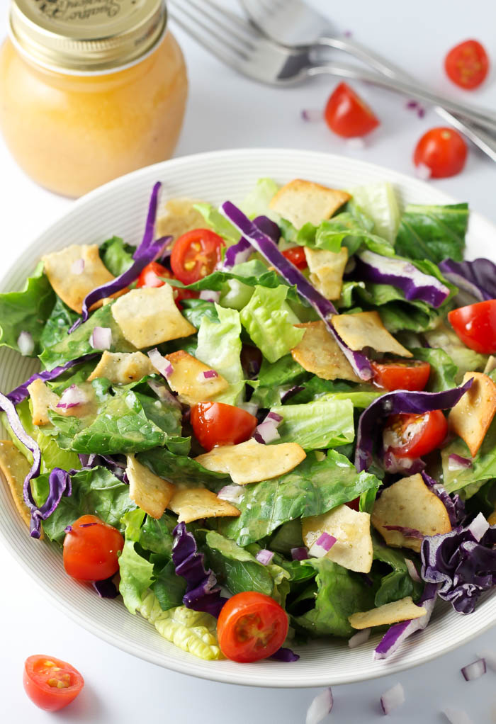 Nish Nosh Salad- This nish nosh salad recipe is utterly addicting. Fresh lettuce, crunchy nish nosh crackers, and a sweet and tangy dressing is the PERFECT marriage. You'll see. passthechallah.com