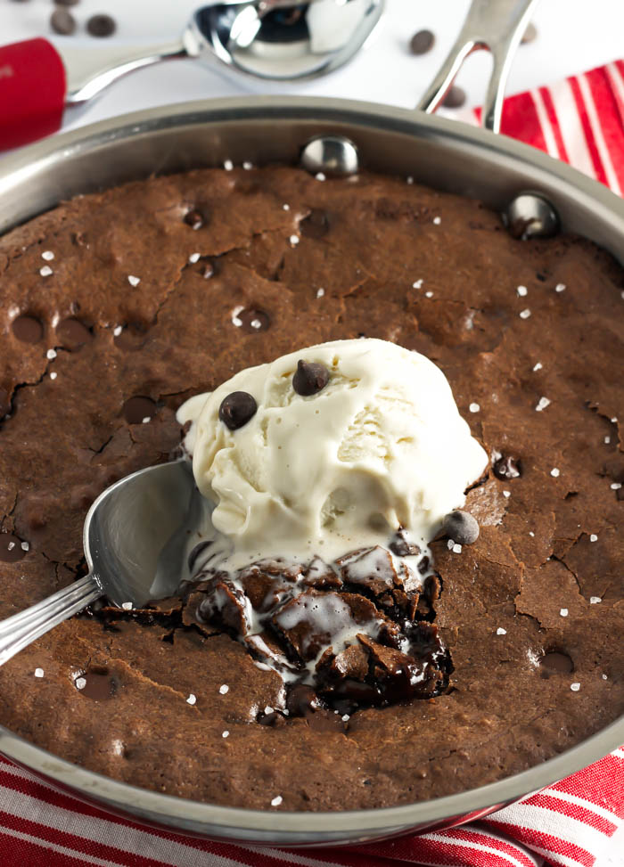 Skillet Sea Salt Brownies- A perfectly fudgy, gooey, warm brownie topped with vanilla ice cream and a sprinkling of sea salt. Served right from the oven, dessert can't get any better! passthechallah.com